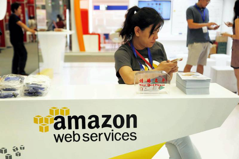 --FILE--A Chinese employee is pictured at the stand of AWS (Amazon Web Services) during the 15th China Digital Entertainment Expo, also known as ChinaJoy 2017, 27 July 2017.  Amazon.com Inc is ramping up efforts in the Chinese market, hiring people to fill job vacancies ranging from software engineers, operation managers to content editors, in a move to expand its presence in the world's largest e-commerce market. Recruitment information has been posted on the tech heavyweight's online career website and professional networking site LinkedIn. These Chinese-based openings include content strategists to create and manage online content, software development engineers and a senior financial analyst. The number of the openings has reached about 400 on Amazon's career website and more than 900 on LinkedIn, according to a report from Bloomberg.No Use China. No Use France.