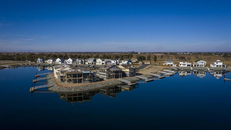 Homes under construction in the Delta Coves housing development on Bethel Island, California, U.S., on Monday, Nov. 10, 2020. Environmental groups in California have filed a lawsuit contesting the approval of revenue bonds to build a massive $16 billion water tunnel under the California Delta, an ecologically sensitive and expansive river estuary south of Sacramento, saying the state hasn't yet completed required impact reviews. Photographer: David Paul Morris/Bloomberg