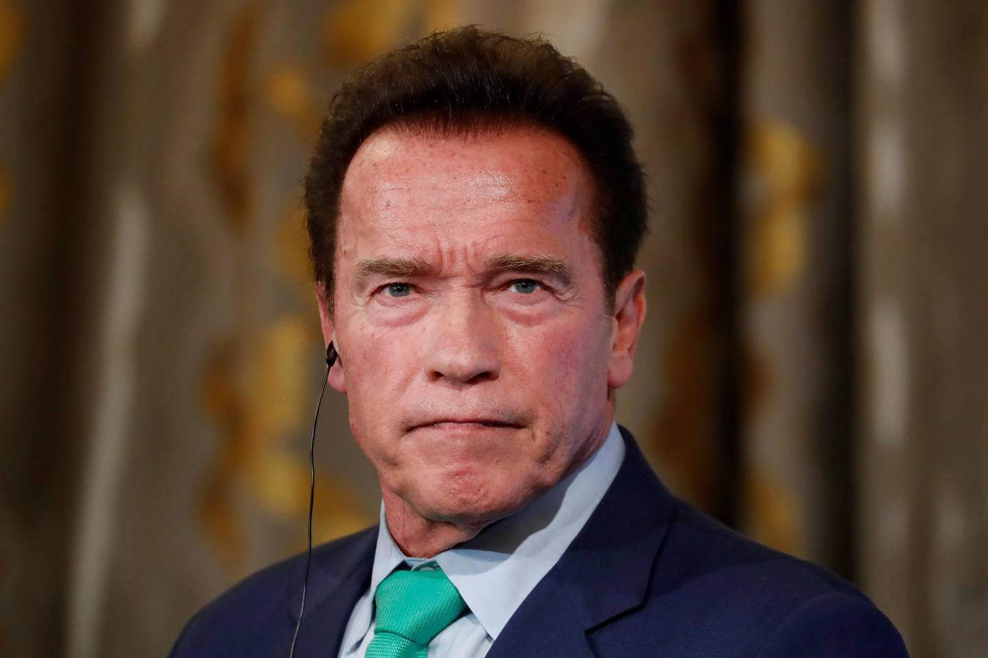 FILE PHOTO - R20 Founder and former California state governor Arnold Schwarzenegger attends a news conference ahead of the One Planet Summit in Paris, France, December 11, 2017. REUTERS/Gonzalo Fuentes/File Photo