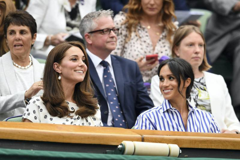 LONDON, ENGLAND - JULY 14:  Catherine, Duchess of Cambridge and Meghan, Duchess of Sussex attend day twelve of the Wimbledon Lawn Tennis Championships at All England Lawn Tennis and Croquet Club on July 14, 2018 in London, England.  (Photo by Clive Mason/Getty Images)