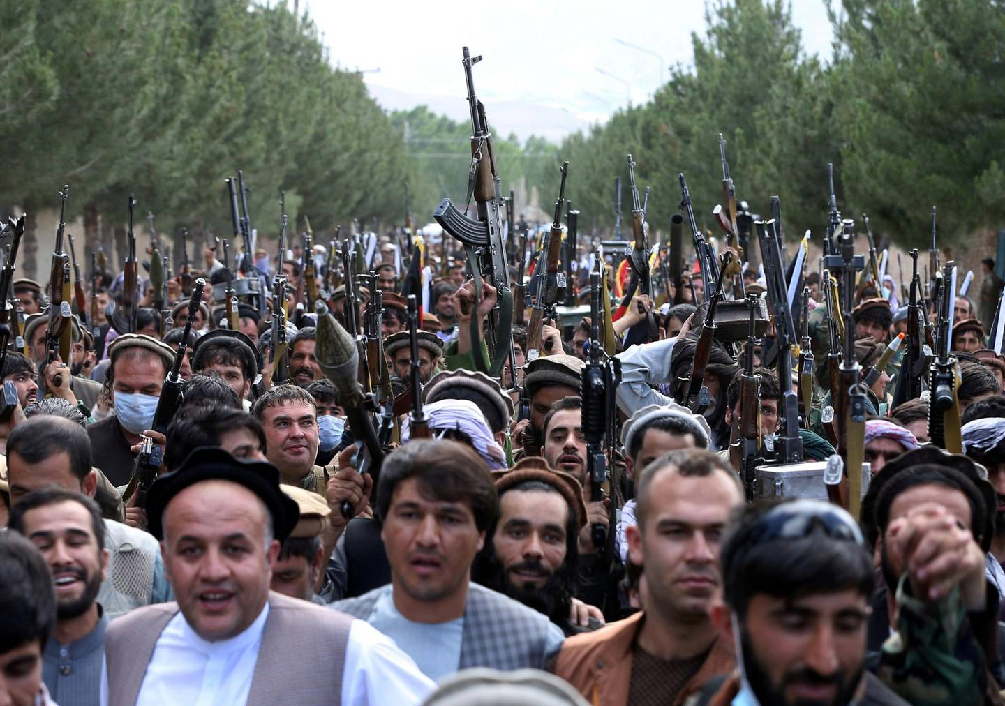Hundreds of armed men attend a gathering to announce their support for Afghan security forces and that they are ready to fight against the Taliban, on the outskirts of Kabul, Afghanistan June 23, 2021. REUTERS/Stringer     TPX IMAGES OF THE DAY