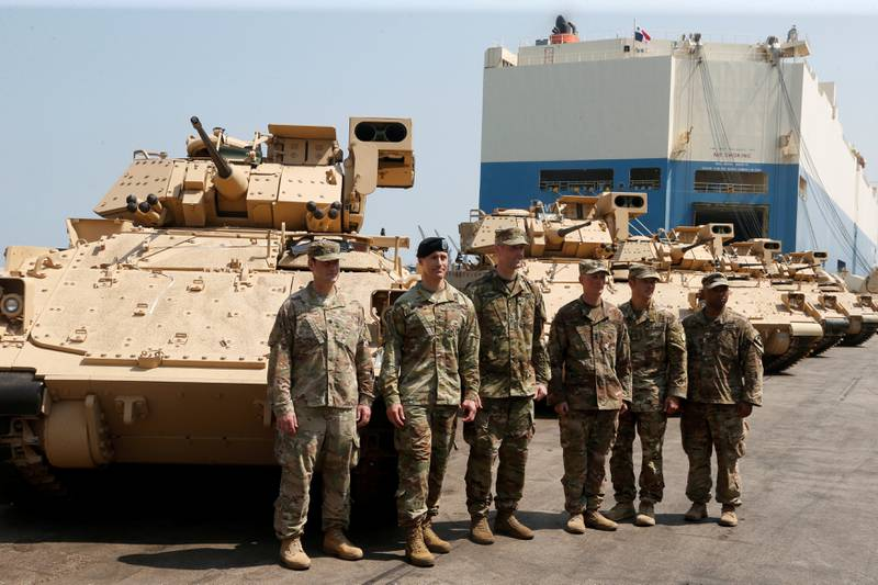 American soldiers stand near armoured fighting vehicles contributed by the U.S. government to the Lebanese army at Beirut's port, Lebanon, August 14, 2017. REUTERS/Mohamed Azakir