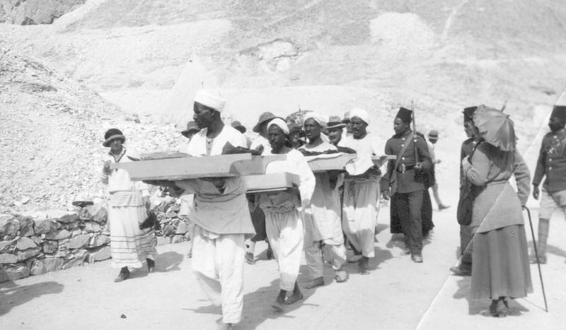 February 1923:  Bearers remove objects from the tomb of King Tutankhamen in the Valley of the Kings near Luxor.  (Photo by Hulton Archive/Getty Images)