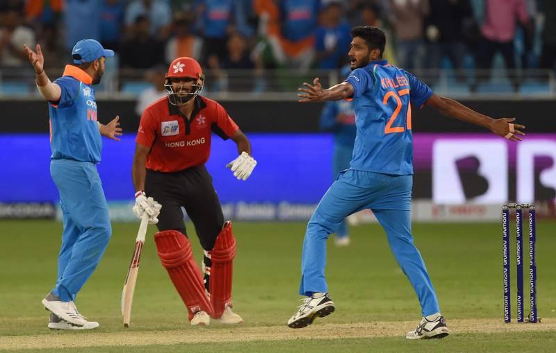 Indian cricketer Khaleel Ahmed (R) celebrates with teammate after he dismissed Hong Kong batsman Nizakat Khan (C) during the one day international (ODI) Asia Cup cricket match between Bangladesh and Sri Lanka at The Dubai International Cricket Stadium in Dubai on September 15, 2018. / AFP / ISHARA S. KODIKARA