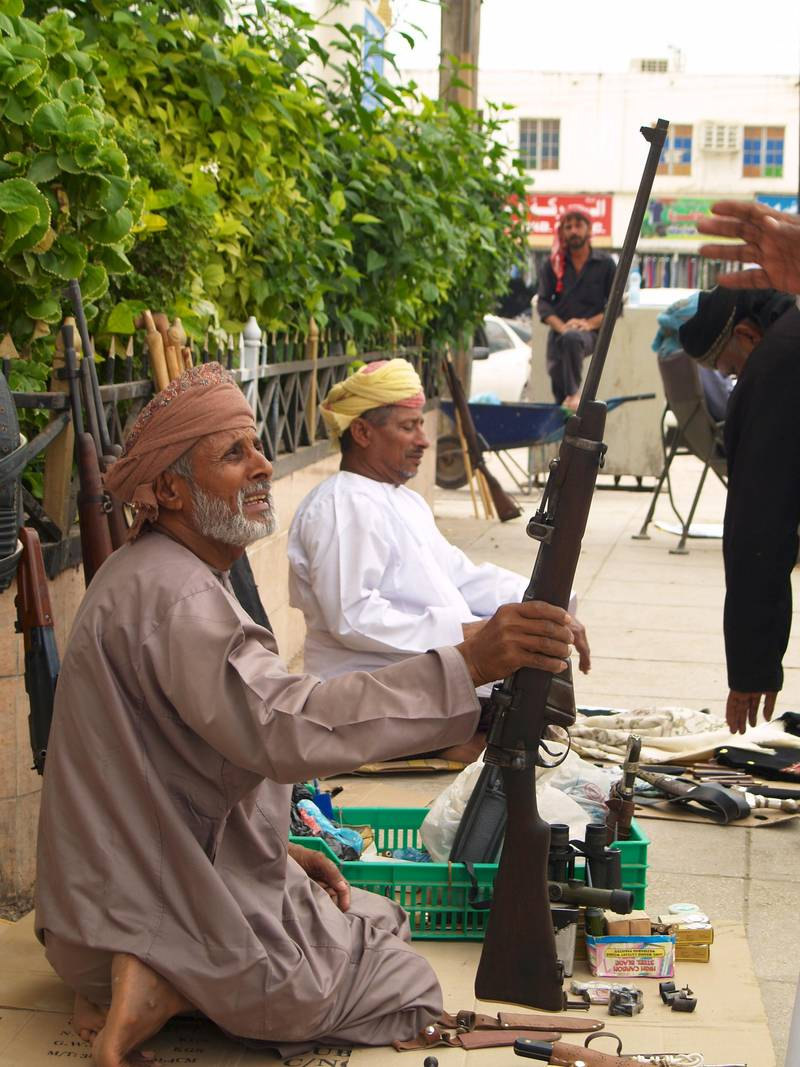 In the old town centre, strategically placed in front of a large bank, is the bustling traditional arms market in Salalah - Paolo Rossetti for The National