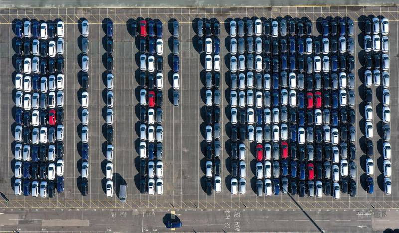 An aerial views shows cars parked up after coming off the production line at the Vauxhall manufacturing plant at Ellesmere Port in north west England on February 22, 2021. / AFP / Paul ELLIS