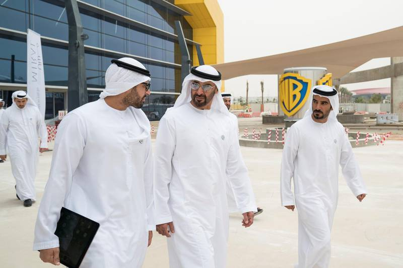 YAS ISLAND, ABU DHABI, UNITED ARAB EMIRATES -  March 1, 2018: HH Sheikh Mohamed bin Zayed Al Nahyan, Crown Prince of Abu Dhabi and Deputy Supreme Commander of the UAE Armed Forces (C), inspects construction of Warner Bros World Abu Dhabi with HE Mohamed Khalifa Al Mubarak Chairman of the Department of Culture and Tourism and Abu Dhabi Executive Council Member (L), and Mohamed Abdalla Al Zaabi CEO of Miral (R).  ( Ryan Carter for the Crown Prince Court - Abu Dhabi ) ---
