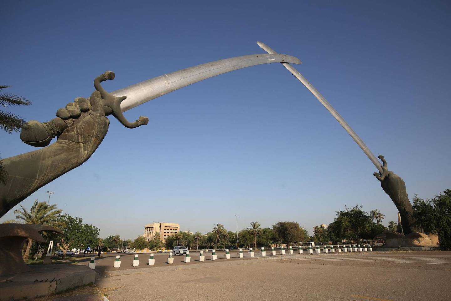A picture taken on June 3, 2019 shows the Victory Arch known as the Swords of Qadisiyah in Baghdad's high-security Green Zone. The Green Zone, home to the Iraqi parliament and US embassy, will be opened to traffic around the clock from Tuesday, the government said. It has been heavily fortified since the US-led invasion that overthrew dictator Saddam Hussein in 2003, with nearly all Iraqis denied access to its 10 square kilometres. / AFP / AHMAD AL-RUBAYE