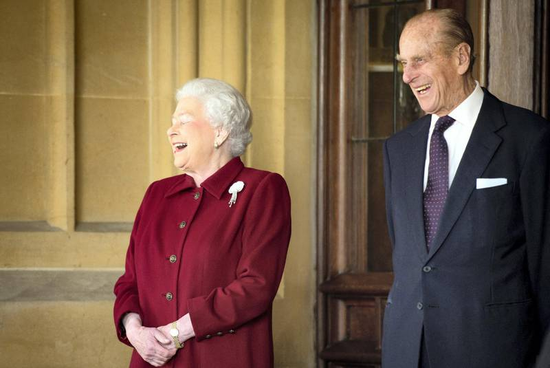 WINDSOR, ENGLAND - APRIL 11:  Britain's Queen Elizabeth II and Prince Philip, Duke of Edinburgh react as they bid farewell to Irish President Michael D. Higgins and his wife Sabina (not pictured) at the end of their official visit at Windsor Castle on April 11, 2014 in Windsor, United Kingdom. Ireland's Michael D. Higgins is making the first state visit by a president of the republic since it gained independence from neighbouring Britain. The visit comes three years after Queen Elizabeth II made a groundbreaking trip to the republic, which helped to heal deep-rooted unease and put British-Irish relations on a new footing.  (Photo by Leon Neal-WPA Pool/Getty Images)