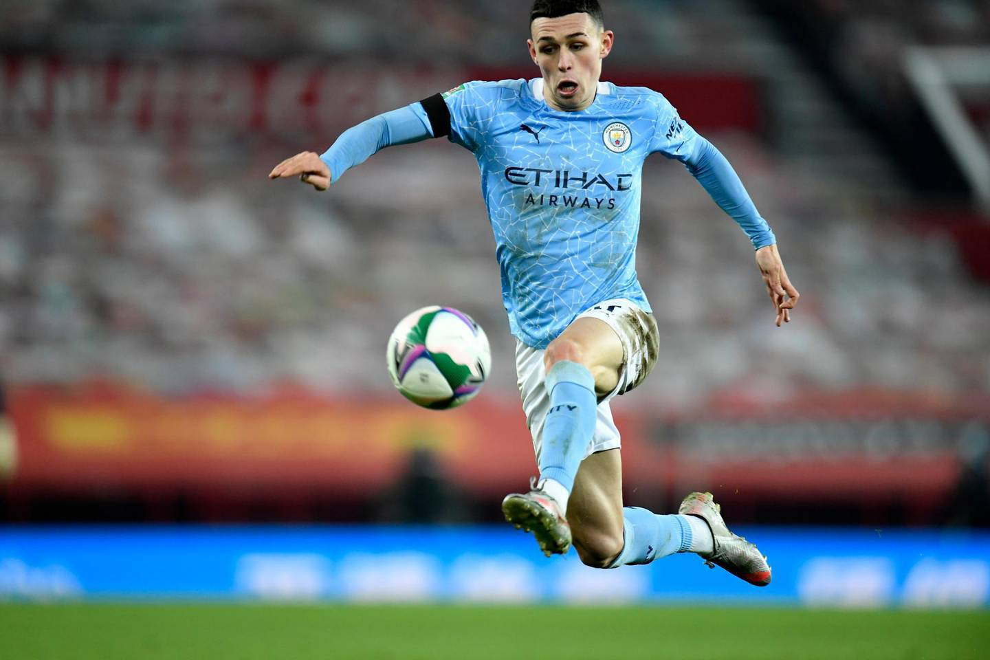 Manchester City's Phil Foden controls the ball during the English League Cup semifinal soccer match between Manchester United and Manchester City at Old Trafford in Manchester, England, Wednesday, Jan. 6, 2021. (Peter Powell/Pool via AP)