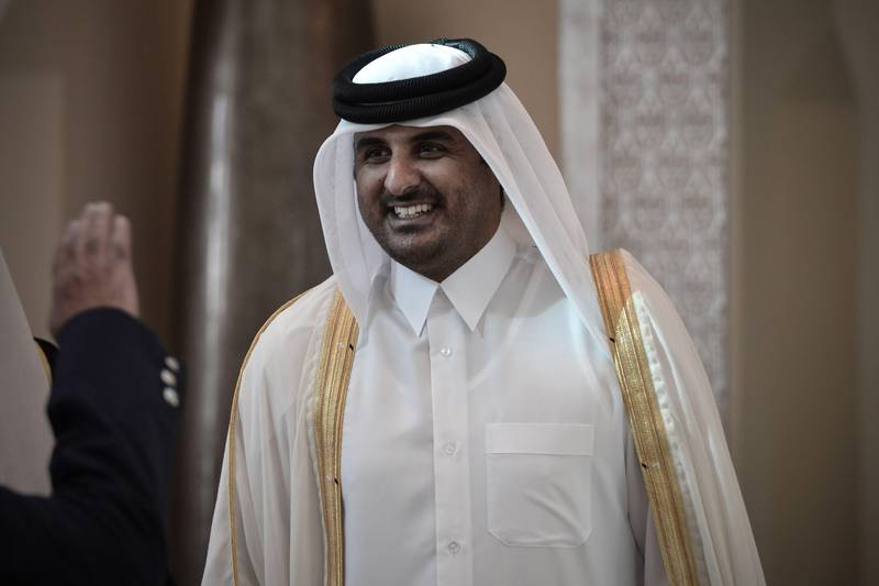 (FILES)- A December 24, 2012, file photo shows Qatari Crown Prince Sheikh Tamim bin Hamad al-Thani smiling as he arrives in the Bahraini capital of Manama, to attend the annual Gulf Cooperation Council (GCC) summit. The Emir of Qatar, Sheikh Hamad bin Khalifa al-Thani, is expected to meet members of the royal family on June 24, 2013, with Qatari officials and diplomats saying a transfer of power to his son, Crown Prince Sheikh Tamim bin Hamad al-Thani, is imminent.  AFP PHOTO / MOHAMMED AL-SHAIKH  *** Local Caption ***  412451-01-08.jpg