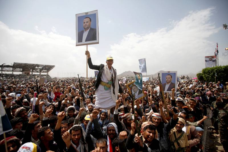 Houthi supporters hold posters of Saleh al-Samad, a senior Houthi official, during a funeral procession held for him and his six body guards, killed by Saudi-led air strikes last week, in Sanaa, Yemen April 28, 2018. REUTERS/Mohamed al-Sayaghi     TPX IMAGES OF THE DAY