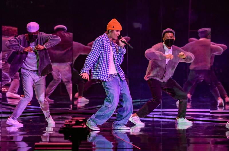 """In this handout image courtesy of ABC singer Justin Bieber performs during the 2020 American Music Awards at the Microsoft theatre on November 22, 2020 in Los Angeles. (Photo by American Broadcasting Companies, Inc. / ABC / AFP) / RESTRICTED TO EDITORIAL USE - MANDATORY CREDIT """"AFP PHOTO / Courtesy of ABC"""" - NO MARKETING - NO ADVERTISING CAMPAIGNS - DISTRIBUTED AS A SERVICE TO CLIENTS"""