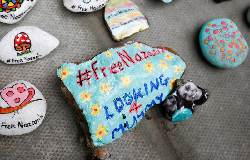 Stones with messages are placed on the pavement outside the Foreign and Commonwealth Office during a demonstration to demand the release of Nazanin Zaghari-Ratcliffe who is imprisoned in Iran, in London, Britain, March 10, 2018. REUTERS/Henry Nicholls