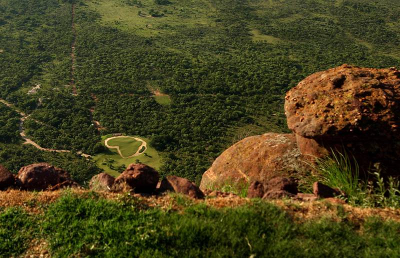 ENTABENI, SOUTH AFRICA - JANUARY 07:  A view of the Extreme 19th hole from the tee, Par 3 631m long, where the tee is at the top of Hanglip mountain and the green is the shape of Africa at the Legend Golf Course on the Entabeni Safari Reserve on January 7, 2009 in Entabeni, South Africa. The Legend Golf Course has been designed by 18 different golfers, each one doing an entire hole, plus an extreme 19th 631m long par 3  (Photo by Richard Heathcote/Getty Images)