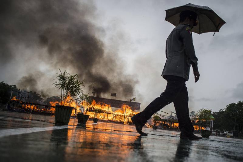 """TOPSHOT - Myanmar law enforcement authorities burn seized illegal drugs worth 187 million USD, marking the International Day against Drug Abuse and Illicit Trafficking during a ceremony in Yangon on June 26, 2018.                The ceremony was among several destruction events that took place on June 26 across Southeast Asia, home to the infamous """"Golden Triangle"""", a zone bisecting Thailand, Myanmar, China and Laos that is the world's second largest drug producing area. / AFP / Ye Aung THU"""