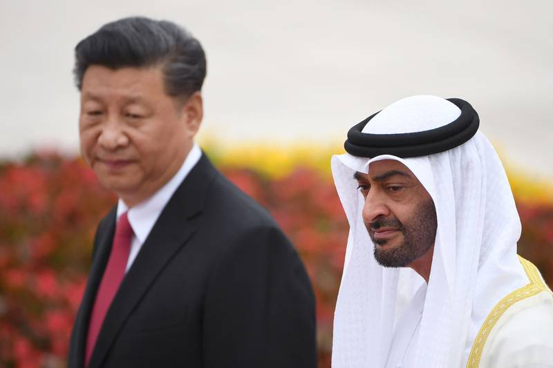 Abu Dhabi Crown Prince Mohammed bin Zayed (R) walks with China's President Xi Jinping during a welcoming ceremony outside the Great Hall of the People in Beijing on July 22, 2019. / AFP / GREG BAKER