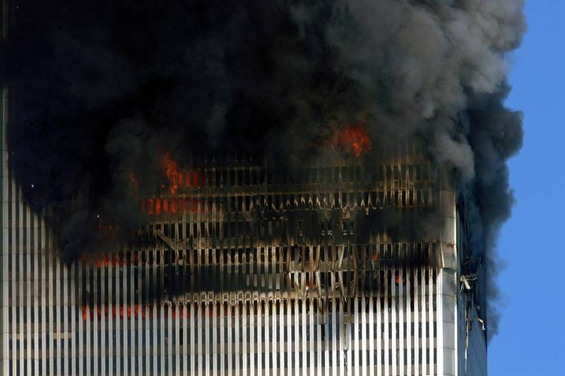 Smoke and flames billow out of the World Trade towers before its collapse 11 September, 2001 in New York.   AFP PHOTO   Henny Ray ABRAMS (Photo by HENNY RAY ABRAMS / AFP)