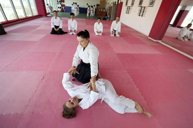 Dubai, United Arab Emirates - July 20, 2019: Cathy Darnell with Anna Monastirskaya. Cathy Darnell is the only female Aikido instructor in Dubai and is a 4th dan, she has the oldest dojo in the country, Zanshinkan Aikido club Dubai is celebrating our 25th anniversary in 2020. Saturday the 20th of July 2019. Al Barsha, Dubai. Chris Whiteoak / The National