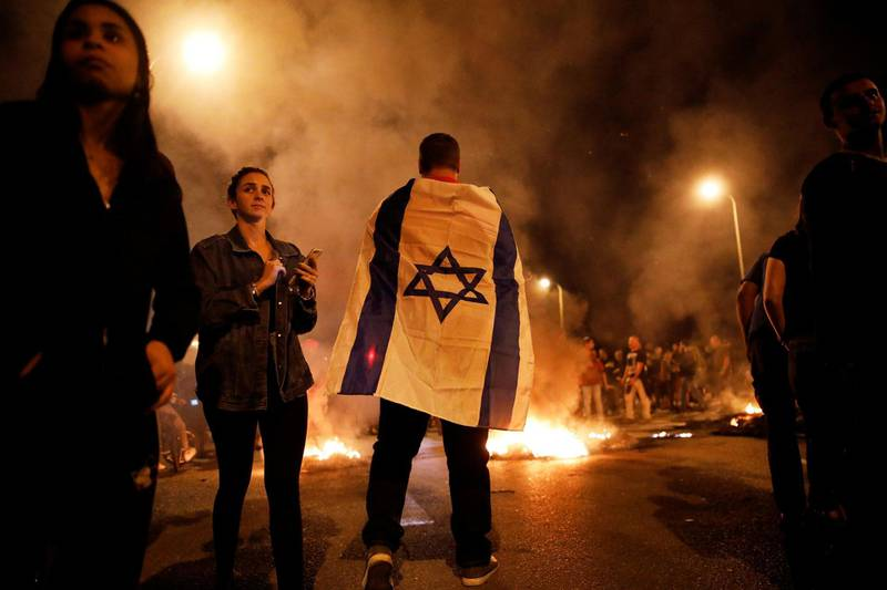 Residents of southern Israel protest against their government's decision to hold fire in Gaza in response to a similar decision by Palestinian militants, in Sderot, Israel November 13, 2018 REUTERS/ Amir Cohen