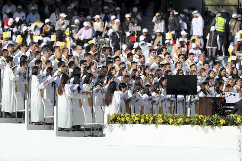 Abu Dhabi, United Arab Emirates - February 05, 2019: The choir sings. Pope Francis takes a large public mass to mark his land mark visit to the UAE. Tuesday the 5th of February 2019 at Zayed Sports city stadium, Abu Dhabi. Chris Whiteoak / The National