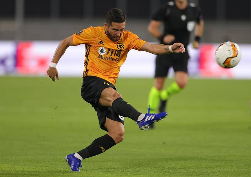 DUISBURG, GERMANY - AUGUST 11: Joao Moutinho of Wolverhampton Wanderers shoots during the UEFA Europa League Quarter Final between Wolves and Sevilla at MSV Arena on August 11, 2020 in Duisburg, Germany. (Photo by Friedemann Vogel/Pool via Getty Images)