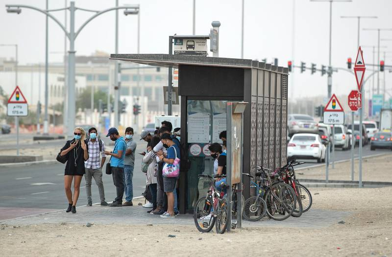 Commuters wait for their bus during gusty winds in Khalifa City, Abu Dhabi on the 28th of April, 2021. Victor Besa / The National.