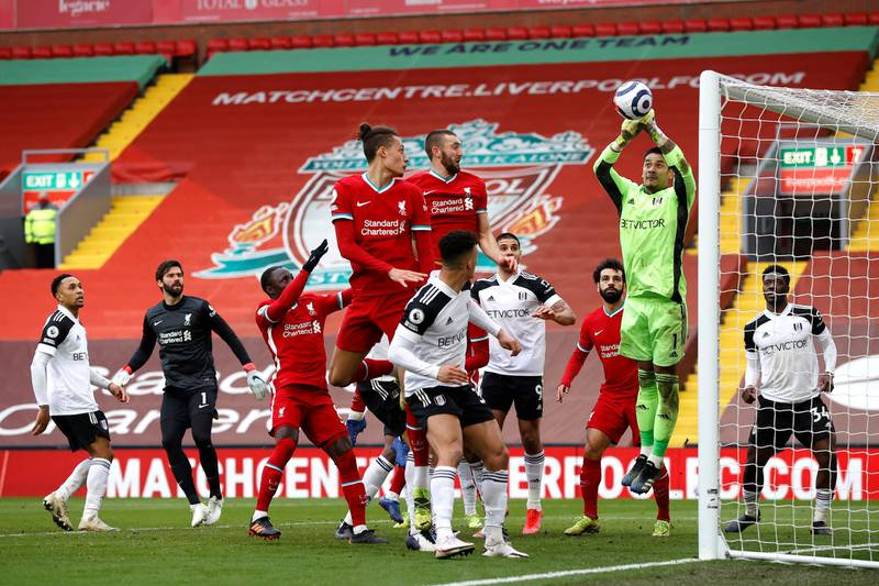 LIVERPOOL, ENGLAND - MARCH 07: Alphonse Areola of Fulham catches the ball during the Premier League match between Liverpool and Fulham at Anfield on March 07, 2021 in Liverpool, England. Sporting stadiums around the UK remain under strict restrictions due to the Coronavirus Pandemic as Government social distancing laws prohibit fans inside venues resulting in games being played behind closed doors. (Photo by Phil Noble - Pool/Getty Images)