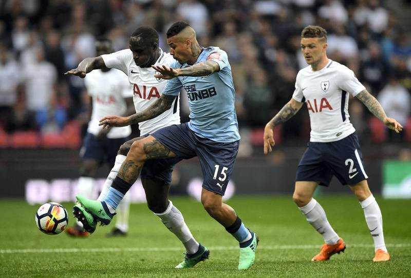 LONDON, ENGLAND - MAY 09: Moussa Sissoko of Tottenham Hotspur is challenged by Kenedy of Newcastle United during the Premier League match between Tottenham Hotspur and Newcastle United at Wembley Stadium on May 9, 2018 in London, England.  (Photo by Stu Forster/Getty Images)