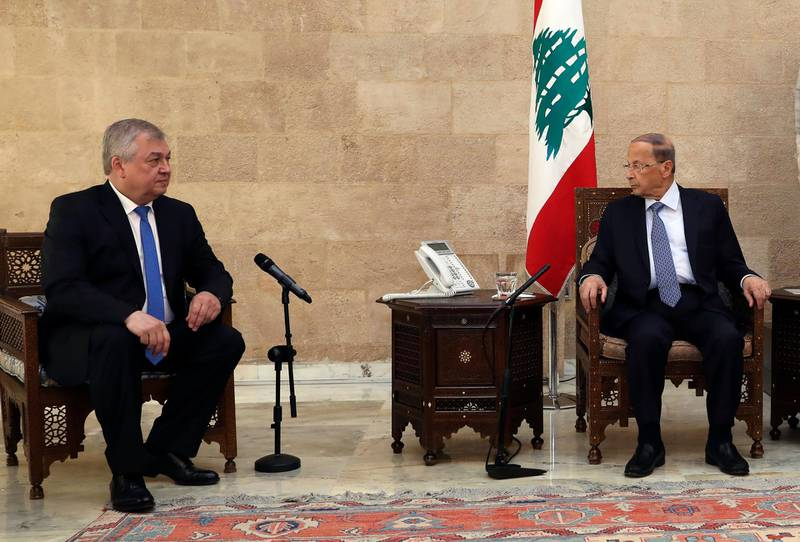 In this photo released by Lebanon's official government photographer Dalati Nohra, Russia's special presidential envoy to Syria Alexander Lavrentiev, left, meets with Lebanese President Michel Aoun, at the presidential palace, in Baabda east of Beirut, Lebanon, Thursday, July 26, 2018. The Russian delegation is in Lebanon to discuss Russian proposals for organizing the return of Syrian refugees from Lebanon and Syria to their homes in Syria. (Dalati Nohra via AP)