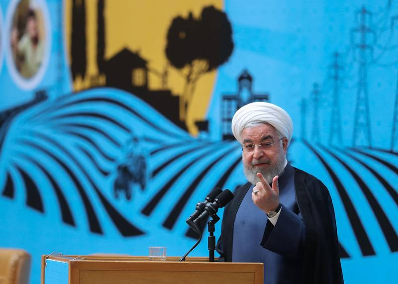 """A handout picture provided by the Iranian presidency on August 26, 2019 shows Iran's President Hassan Rouhani speaking in the capital Tehran at an event marking government achievements in rural areas. Rouhani came out strongly in favour of talks today as his top diplomat came under fire from hardline media for a surprise visit to a G7 summit in France.   - === RESTRICTED TO EDITORIAL USE - MANDATORY CREDIT """"AFP PHOTO / HO / IRANIAN PRESIDENCY"""" - NO MARKETING NO ADVERTISING CAMPAIGNS - DISTRIBUTED AS A SERVICE TO CLIENTS ===  / AFP / Iranian Presidency / - / === RESTRICTED TO EDITORIAL USE - MANDATORY CREDIT """"AFP PHOTO / HO / IRANIAN PRESIDENCY"""" - NO MARKETING NO ADVERTISING CAMPAIGNS - DISTRIBUTED AS A SERVICE TO CLIENTS ==="""