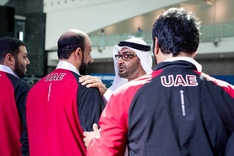 ABU DHABI, UNITED ARAB EMIRATES - March 20, 2019: HH Sheikh Mohamed bin Zayed Al Nahyan, Crown Prince of Abu Dhabi and Deputy Supreme Commander of the UAE Armed Forces (C) presents a medal to an athlete during the Special Olympics World Games Abu Dhabi 2019 at Abu Dhabi National Exhibition Centre.  ( Mohamed Al Hammadi / Ministry of Presidential Affairs ) ---