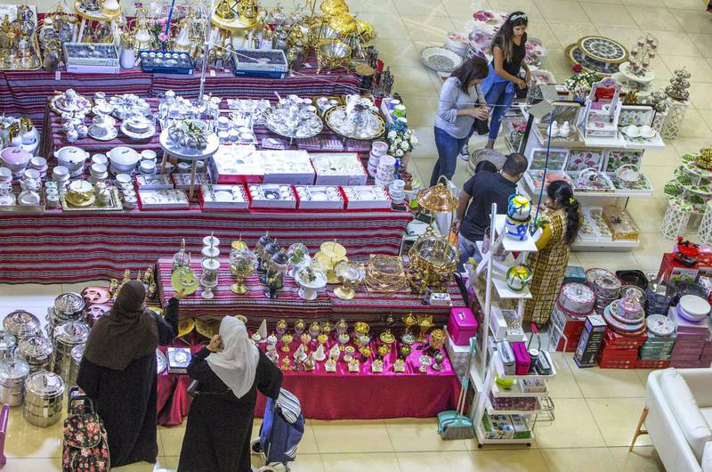 DUBAI, UNITED ARAB EMIRATES, 04 May 2018 - Shoppers checking out different items at Ramadan Market that opens May 3 till 19 at  Dragon Mart 2.  Leslie Pableo for The National for Ellen Fortini's story
