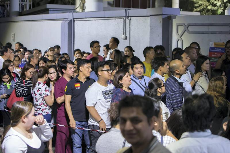 DUBAI, UNITED ARAB EMIRATES -Crowd waiting to get their tickets for the Papal Mass on February 3, 2018 in Abu Dhabi at St. Mary's Catholic Church, Oud Mehta.  Leslie Pableo for The National for Patrick Ryan's story