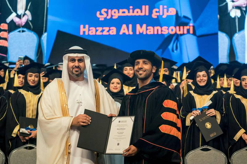 ABU DHABI, UNITED ARAB EMIRATES - October 20, 2019: HH Sheikh Theyab bin Mohamed bin Zayed Al Nahyan, Abu Dhabi Executive Council member and Chairman of the abu Dhabi Crown Prince Court (CPC) (L), presents a certificate to Astronaut Major Hazza Al Mansouri (R), during the Khalifa University Graduation Ceremony, at Emirates Palace.  ( Hamad Al Kaabi / Ministry of Presidential Affairs ) ---