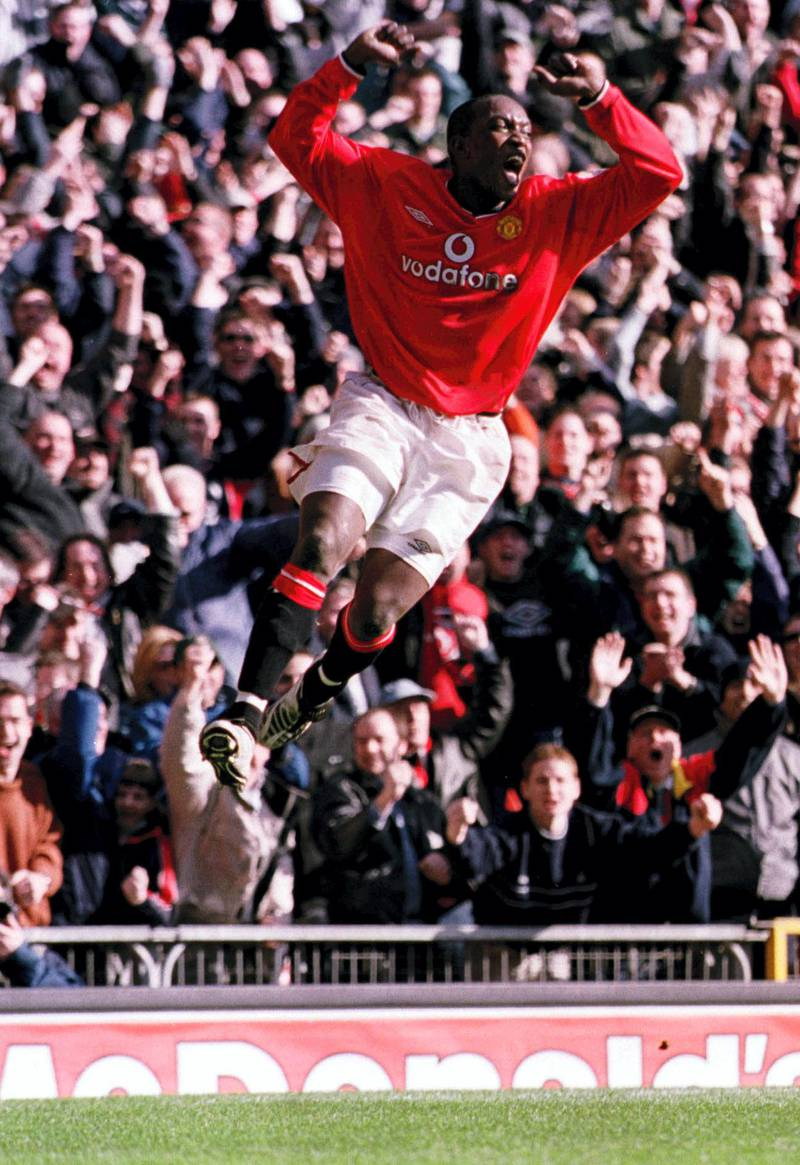 25 Feb 2001:  Dwight Yorke of Man Utd celebrates after scoring his second goal during the FA Carling Premiership match between Manchester United and Arsenal played at Old Trafford in Manchester. Mandatory Credit: Gary M. Prior/ALLSPORT