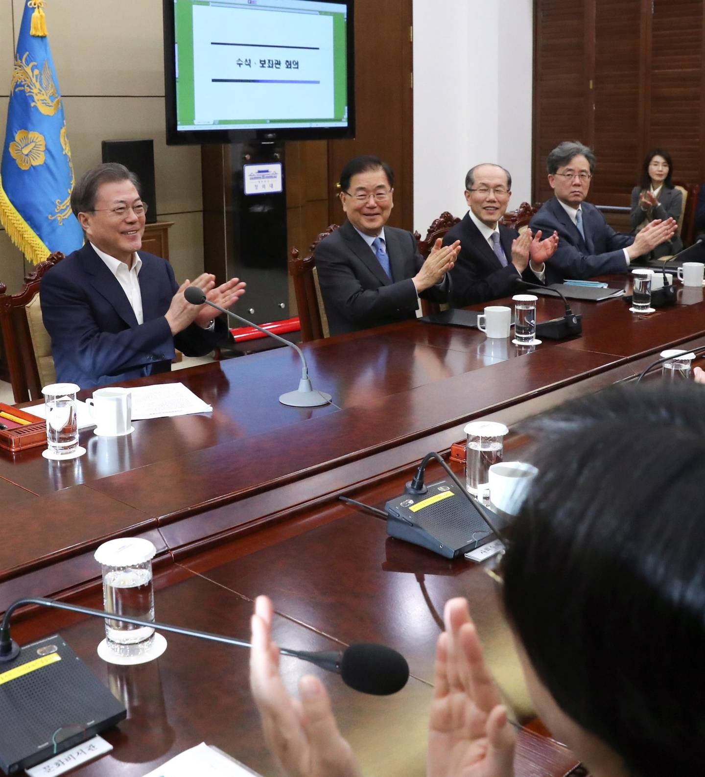 epa08208264 South Korean President Moon Jae-in (L) and his top secretaries react after hearing the news that South Korean director Bong Joon-ho won four Academy Awards, prior to a meeting at the presidential office in Seoul, South Korea, 10 February 2020. Bong Joon-ho's movie Parasite won four Academy Awards on 09 February for Best Original Screenplay, Best International Feature Film, Best Director and Best Picture. It is the first time a foreign-language movie wins the Academy Award for Best Picture.  EPA/YONHAP SOUTH KOREA OUT