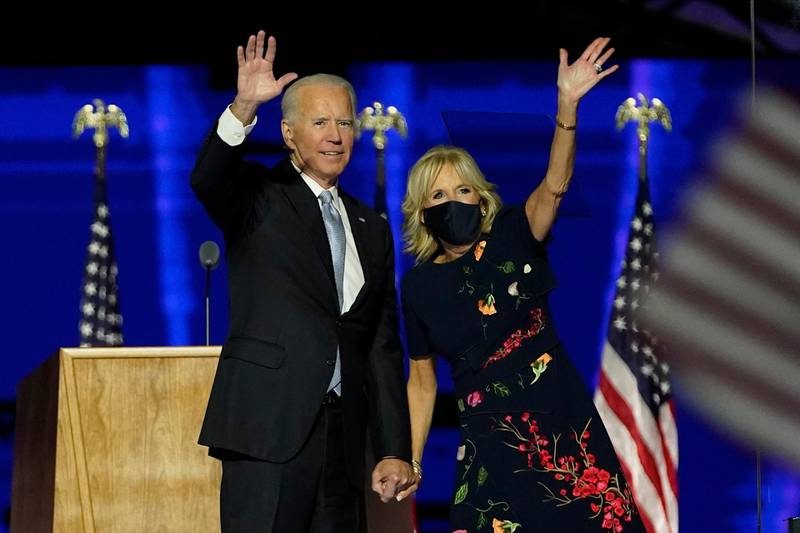 epa08806563 President-elect Joe Biden (L) with his wife Jill Biden (R) wave to supporters during celebratory event held outside of the Chase Center in Wilmington, Delaware, USA, 07 November 2020. According to media reports, Biden has defeated President Donald Trump in the 2020 USA presidential election to become the United Sates' 46th president.  EPA/Robert Deutsch / POOL