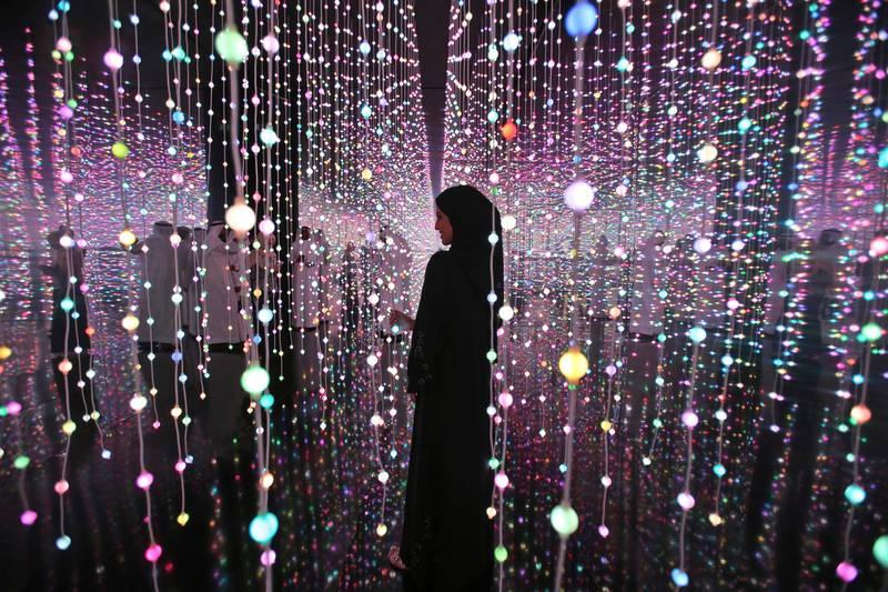 An Emirati woman pauses at the Museum of the Future of the World Government Summit in Dubai, United Arab Emirates, Monday, Feb. 12, 2018. (AP Photo/Kamran Jebreili)