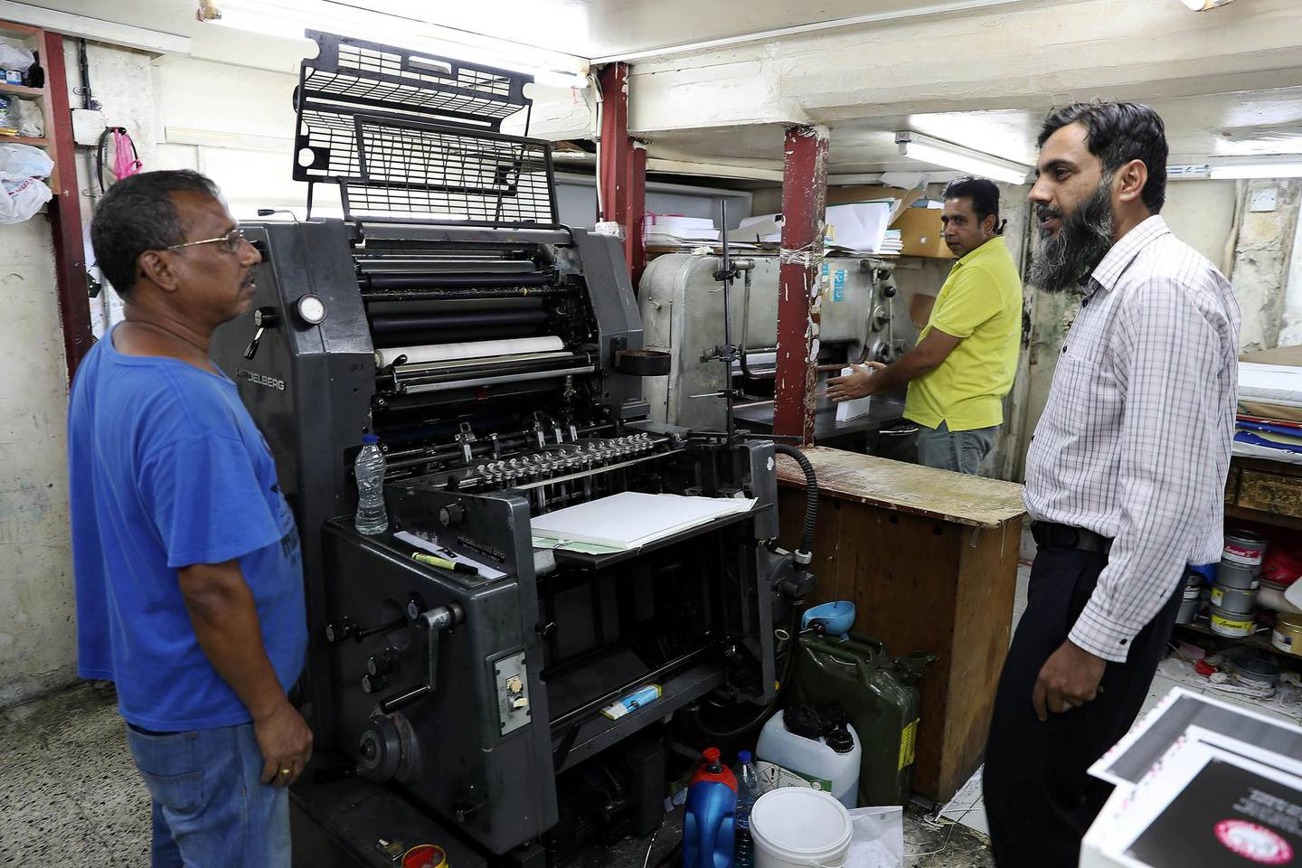 ABU DHABI , UNITED ARAB EMIRATES, September 9 – 2018 :- Naveed Baig ( right ) , manager of the Al Mujahid Printing Press & Stationery with the workers at the press in one of the old building at the Tourist Club area in Abu Dhabi. ( Pawan Singh / The National )  For News. Story by Anna/ John