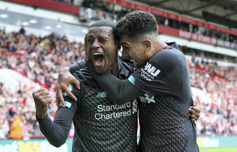 Liverpool's Georginio Wijnaldum celebrates scoring his side's first goal of the game with team-mate Roberto Firmino during the Premier League match at Bramall Lane, Sheffield.