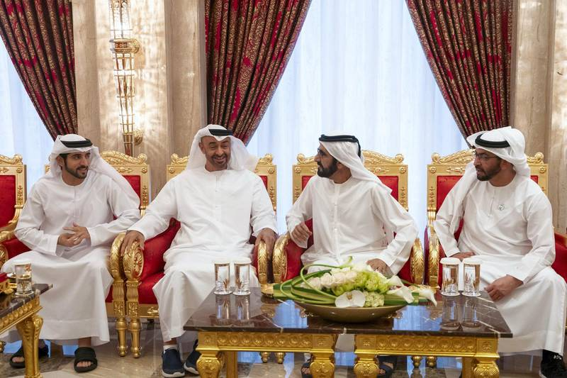 DUBAI, UNITED ARAB EMIRATES - May 19, 2019: HH Sheikh Mohamed bin Zayed Al Nahyan, Crown Prince of Abu Dhabi and Deputy Supreme Commander of the UAE Armed Forces (2nd L), attends an iftar reception hosted by HH Sheikh Mohamed bin Rashid Al Maktoum, Vice-President, Prime Minister of the UAE, Ruler of Dubai and Minister of Defence (3rd L), at Zabeel Palace. Seen with HH Sheikh Hamdan bin Mohamed Al Maktoum, Crown Prince of Dubai (L) and HH Sheikh Hamdan bin Zayed Al Nahyan, Ruler's Representative in Al Dhafra Region (R).  ( Mohamed Al Hammadi / Ministry of Presidential Affairs ) ---