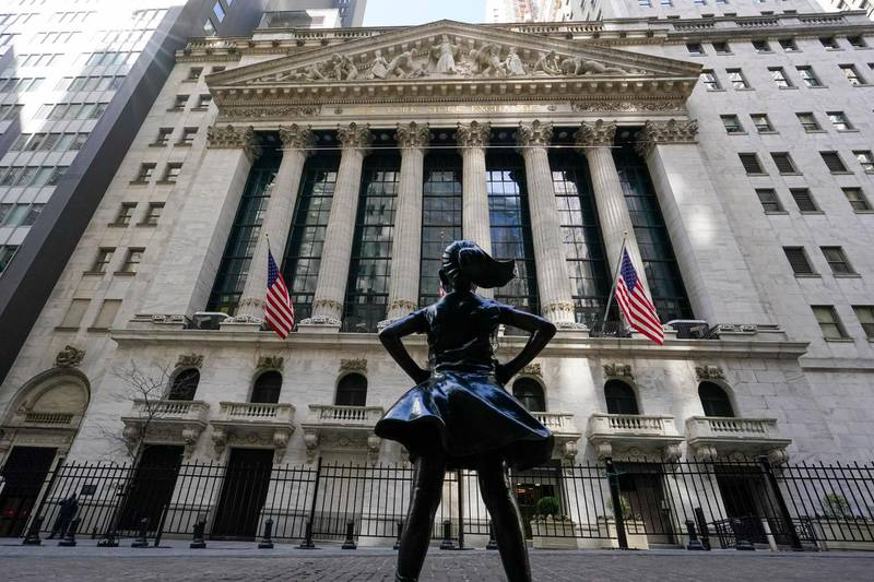 The Fearless Girl statue stands in front of the New York Stock Exchange in New York's Financial District, Tuesday, March 23, 2021.  Stocks are off to a solid start on Wall Street as banks made up some of the ground they lost a day earlier. Industrial companies were also strong early Wednesday, March 24 helping to push the benchmark S&P 500 index up 0.5% in the first few minutes of trading. (AP Photo/Mary Altaffer)