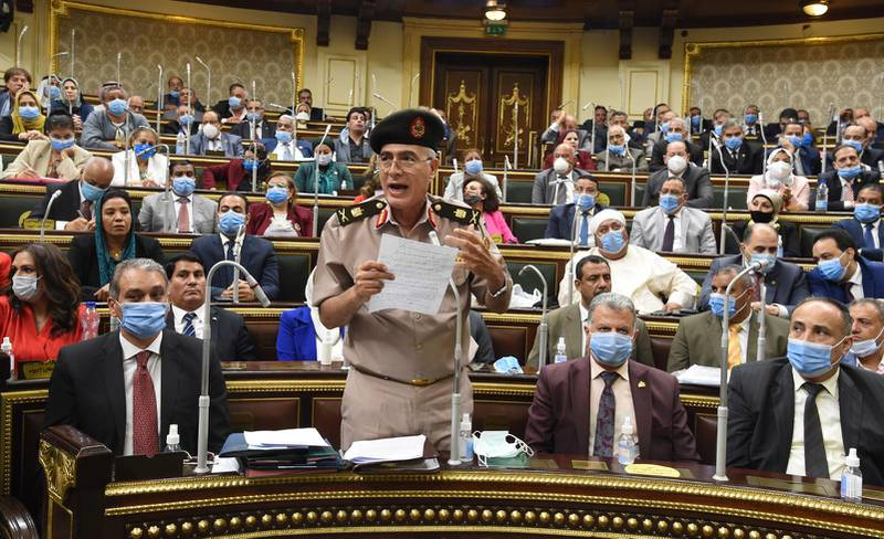 epa08557074 Egyptian General Mamdoh Shahen (2-L) holds up handwritten notes as he speaks during a parliamentary debate session to discuss and vote whether Egypt should send troops to the neighboring civil-war-torn nation of Libya, in Cairo, Egypt, 20 July 2020. According to media reports, the motion passed as the unicameral legislative body effectively rubber-stamped this foreign military deployment.  EPA/KHALED MASHAAL