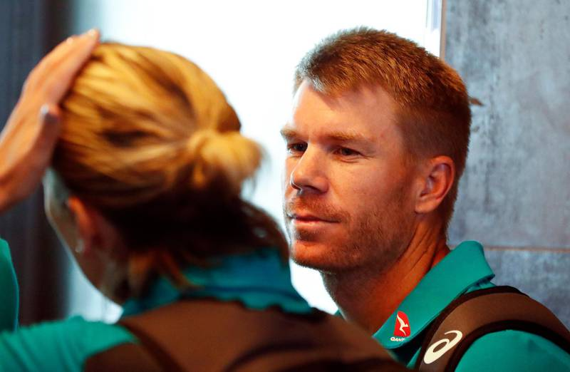 epa06631761 Australian cricket player David Warner (R) departs from Cape Town International airport, South Africa, 27 March 2018. Australia skipper Steve Smith has been suspended by the International Cricket Council (ICC) for his part in a ball tampering scandal during the third test against South Africa. Smith admitted some senior players were aware of the ball tampering attempt. Smith and Warner stepped down as captain and vice-captain of the Australian team in consequence to the ball meddling scandal.  EPA/NIC BOTHMA