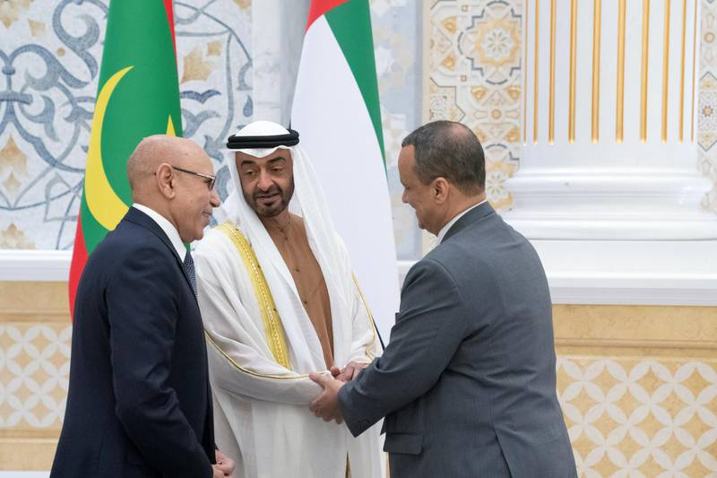 ABU DHABI, UNITED ARAB EMIRATES - February 02, 2020: HH Sheikh Mohamed bin Zayed Al Nahyan, Crown Prince of Abu Dhabi and Deputy Supreme Commander of the UAE Armed Forces (C) greets a member of the Mauritanian delegation accompanying HE Mohamed Ould Ghazouani, President of Mauritania (L), during an official visit reception, at Qasr Al Watan.   ( Hamad Al Kaabi / Ministry of Presidential Affairs ) ---