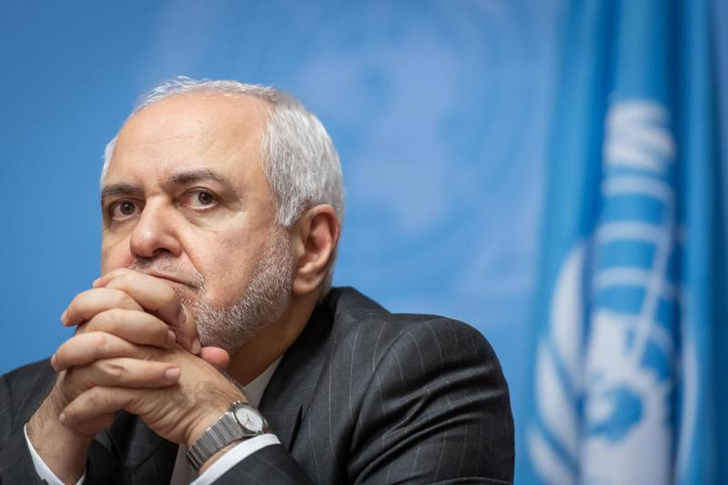 Iranian Foreign Minister Mohammad Javad Zarif looks on as he attends  a press conference on a meeting of the Syria constitution-writing committee on October 29, 2019 at the United Nations Offices in Geneva. / AFP / FABRICE COFFRINI