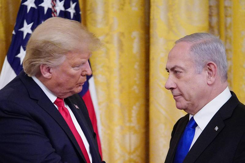 """TOPSHOT - US President Donald Trump and Israel's Prime Minister Benjamin Netanyahu take part in an announcement of Trump's Middle East peace plan in the East Room of the White House in Washington, DC on January 28, 2020. Trump declared that Israel was taking a """"big step towards peace"""" as he unveiled a plan aimed at solving the Israeli-Palestinian conflict. """"Today, Israel takes a big step towards peace,"""" Trump said, standing alongside Netanyahu as he revealed details of the plan already emphatically rejected by the Palestinians. / AFP / MANDEL NGAN"""