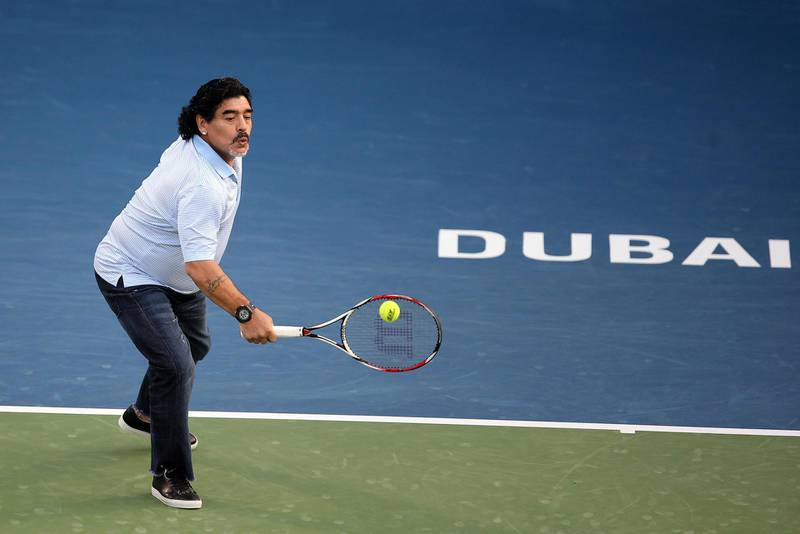 epa03603015 Former Argentinian soccer player Diego Armando Maradona performs after watching the second round match between his compatriot Juan Martin Del Potro and Somdev Devvarman of India at the Dubai Duty Free Tennis ATP Championships in Dubai, United Arab Emirates, 27 February 2013.  EPA/ALI HAIDER *** Local Caption ***  03603015.jpg