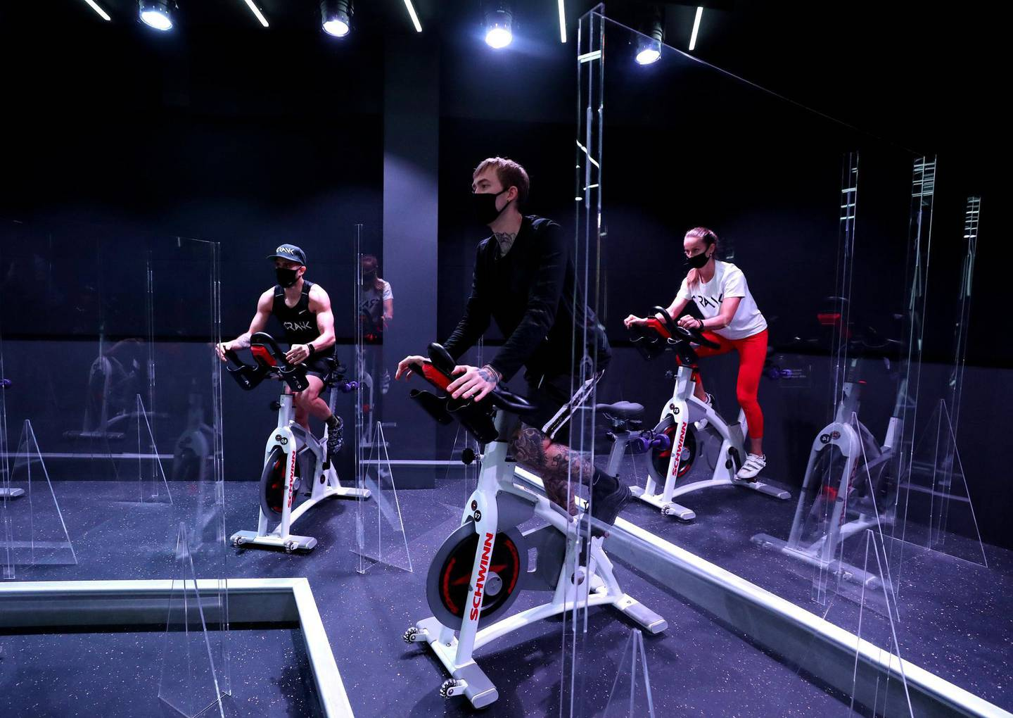 Dubai, United Arab Emirates - Reporter: N/A: News. Covid-19/Coronavirus. Maria, Fraz and Nuno (L) work out. Crank an Indoor Cycling & Boutique Fitness Studio have brought in partitions between bikes to protect their customers from Covid-19. Monday, June 1st, 2020. Dubai. Chris Whiteoak / The National